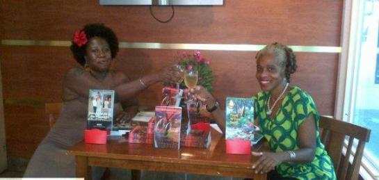 2012 - a toast with friend, writer and interviewer for the evening Brenda Lee Browne, at the televised book club discussion of my first full length novel Oh Gad! Also on the table are The Boy from Willow Bend and my second novella which came out just a year after its release Dancing Nude in the Moonlight.