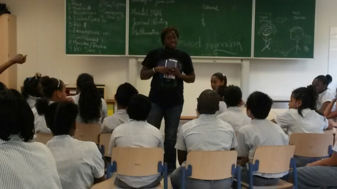 Reading from Musical Youth and chatting with students at Hillside Christian school in St. Martin.