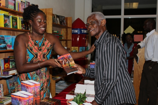 Re inspiration, I should have also mentioned calypso and calypso writers like Shelly Tobitt and Marcus Christopher, the latter pictured with me at my launch in 2012. I've appreciated his feedback on the book and sometimes have to pinch myself that one of the writers whose calypsos I grew up listening to has read a book I've written. (Photo by Eustace Samuel).