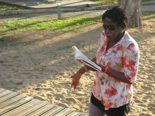 Me reading from Oh Gad! at the International Congress of Caribbean Writers in Guadeloupe (Photo by St. Lucian writer John R Lee)
