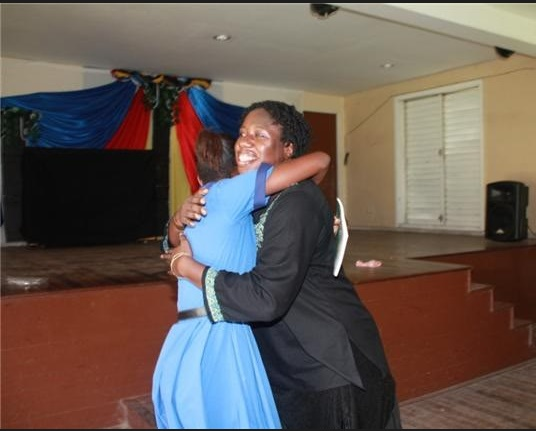 Moments from an AGHS school visit of a few years ago; the hug followed a hand over of a copy of my book The Boy from Willow Bend to one of the students. We also had a signing of the book they were there to grill me about Dancing Nude in the Moonlight.
