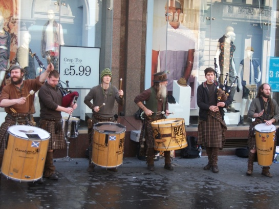 He wasn't the only diversion on the streets of the city. A riot of sound, bag pipes and all.