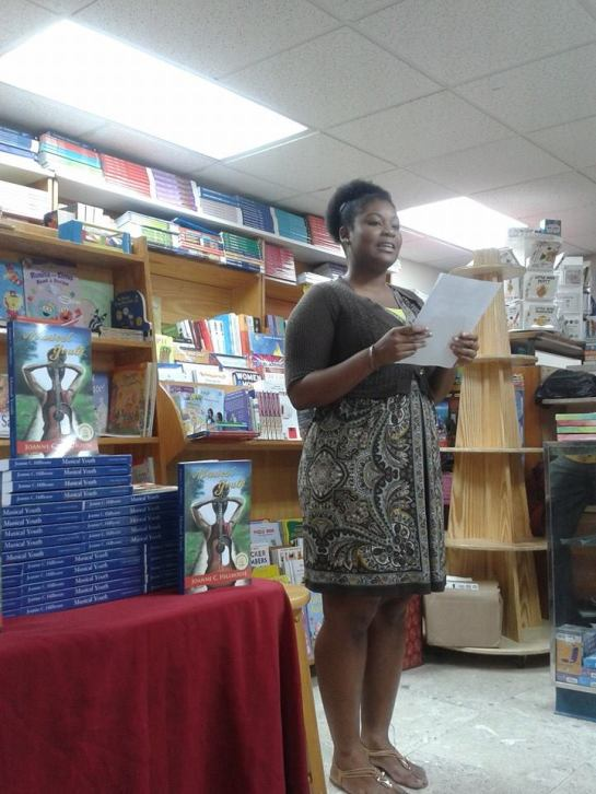 This one is of Alexandra Spence reading her story, Why Did I Get Punished? – Honourable Mention for the 2014 Wadadli Pen Challenge (http://wadadlipen.wordpress.com), a writing programme I run here in Antigua and Barbuda to encourage and support emerging writers here at home. Involving some of the Wadadli Pen finalists in the launch of my book, itself the recipient of a prize in another competition, felt like the perfect coming together of my literary worlds.