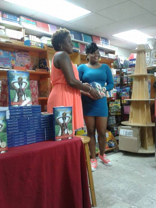 One of those soon-to-be readers was Latisha, a young woman now, but once a young girl I met while a volunteer reader with the Cushion Club. She's pictured here accepting a gift of the books on behalf of the Cushion Club but she gave me the greater gift that night in the form of a card in which she poured out appreciation for my role as a mentor in her life. I was surprised and overwhelmed with emotion, and I just want to encourage her to continue to strive.