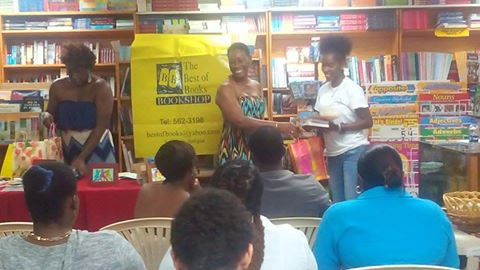 One of the Best of Books picks, Melicia McCalmon, collects her gifts from Best of Books and the Burt Award sponsors CODE.