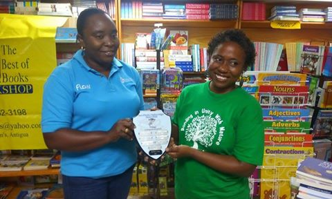 Winner, Margaret Irish, posed up with the Challenge trophy sponsored by the Best of Books. Gavinia Michael of FLOW assists with the presentation. Photo by Glen Toussaint/Best of Books.