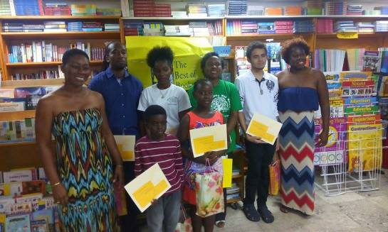 Winners of the 2015 Wadadli Pen flanked by guest presenter Dotsie Isaac Gellizeau (whose new CD is I am Speaking)and co-founder/coordinator Joanne C. Hillhouse (whose latest books are Musical Youth and the Dancing Nude in the Moonlight 10th Anniversary Edition and Other Stories). Pictured between them are Olsfred James, Melicia McCalmon, Judah Christian, Avriel Walters, Margaret Irish and Ondrej Austin-Josiah. Photo by Glen Toussaint/Best of Books.