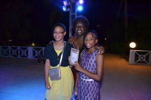 I was hanging with a friend at the poolside cocktail thingee when these two girls approached me - one a spelling bee champ and avid reader, the other a mini-critic in the making...yes, she had her views on Musical Youth and The Boy from Willow Bend...both avid readers and budding writers. Was a joy to meet them. That book they're holding up, it's by the friend I was hanging with Barbara...don't ask me why I'm in the picture and not her. Life's mysteries.