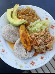"""When Azizah Phillip posted her coconut (or potato) dumpling, saltfish, papaya (or pawpaw/pupa), pumpkin and okra chopup, plantin, and avocado to #ratemyplate268, one commenter declared her """"wife material""""."""