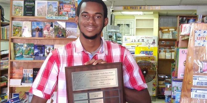 2020 co-winner, with Cheyanne Daroux, Andre Warner, whose story subsequently won a regional prize, holding the Alstyne Allen Memorial plaque, named for the woman who was a key volunteer in Wadadli Pen's early years. The plaque is sponsored by the Best of Books. A second plaque for the 12 and younger winner will be added in the name of Zuri Holder, a former Wadadli Pen 2-time 12 and younger finalist. RIP to Alstyne and Zuri.